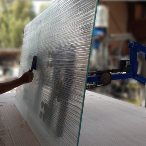 Glass being brushed